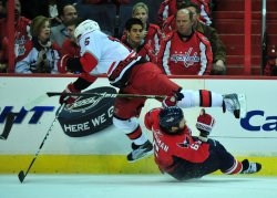 Carolina Hurricanes' Tuomo Ruutu hits Washington Capitals' Dennis Wideman in Washington