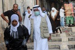 A Palestinian wears protective mask in Jerusalem