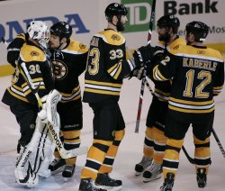 Bruins Thomas and Ference celebrate win over Canucks in game 6 of the NHL Stanley Cup Finals in Boston, MA.