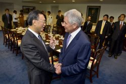 Secretary of Defense Chuck Hagel hosts a meeting with Chinese State Councilor