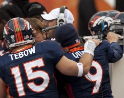 Broncos Head Coach McDaniels Sits with his Quarterbacks in Denver