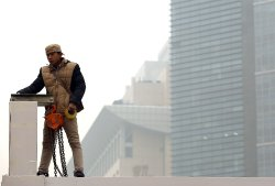 Chinese worker works in hazardous pollution in Beijing