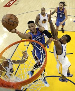 Oklahoma City Thunder's Russell Westbrook goes up for a layup
