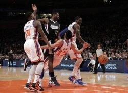 Sacramento Kings Tyreke Evans gets called for a charge on New York Knicks Jeremy Lin at Madison Square Garden in New York