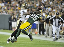 Saints Greer interferes with Packers Jennings in Green Bay, Wisconsin