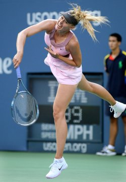 Maria Sharapova takes on Melinda Czink during first-round action at the U.S. Open in New York