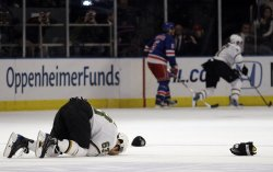 The Dallas Stars Mike Ribeiro holds his head on the ice at Madison Square Garden