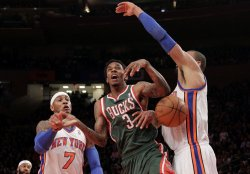Milwaukee Bucks Brandon Jennings has the ball stripped from his hands by New York Knicks Carmelo Anthony and Tyson Chandler at Madison Square Garden in New York