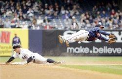 New York Yankees Brett Gardner slides under Minnesota Twins Alexi Casilla at Yankee Stadium in New York
