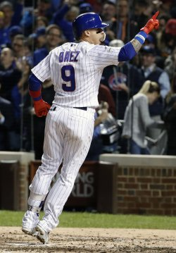 Cubs Baez celebrates second solo home run in the NLCS