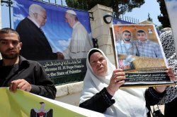 Palestinians Protest Near Banner Of Pope Francis and President Mahmoud Abbas, Bethlehem