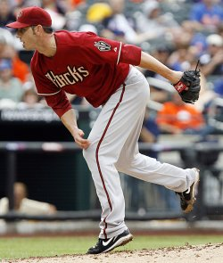 Arizona Diamondbacks starting pitcher Jon Garland throws a pitch against the New York Mets at Citi Field in New York