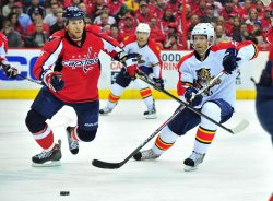 Capitals Dennis Wideman and Panthers Sean Bergenheim fight for the puck in Washington
