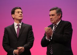 Gordon Brown applauds David Miliband on the final day of the Labour Party Conference 2009.