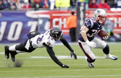 Baltimore Ravens cornerback Jimmy Smith dives to tackle New England Patriots running back Danny Woodhead in the AFC Championship Game at Gillette Stadium in Massachusetts