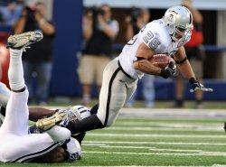 Raiders Justin Fargas rushes against Cowboys