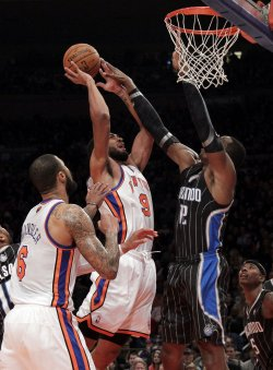 Orlando Magic Dwight Howard tries to block a shot from New York Knicks Jared Jeffries at Madison Square Garden in New York