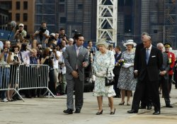 Britain's Queen Elizabeth touches a wreath of flowers 9/11 World Trade Center attack site