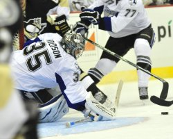 Penguins Craig Adams Scores Against Dwayne Roloson in Pittsburgh