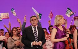 Gordon Brown stands with Labour Party members on the final day of the Labour Party Conference 2009.