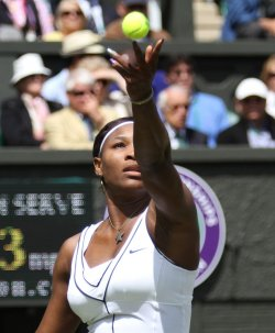 Serena Williams serves at Wimbledon.