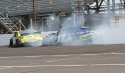 Joey Logano and Matt Kenseth crash during Brickyard 400 in Indianapolis, Indiana.