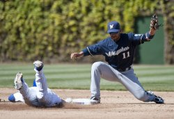 Cubs' Barney Safe at Second Base as Brewers' Gonzalez Catches Throw in Chicago