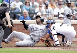 New York Mets Josh Thole tags out New York Yankees Eduardo Nunez at Citi Field in New York