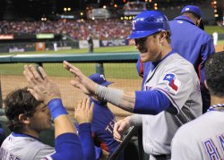 Rangers Josh Hamilton is congratulated in the dugout during game 6 of the World Series in St. Louis