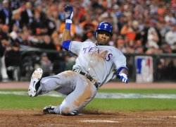 Rangers' Julio Borbon scores during game 1 of the World Series in San Francisco