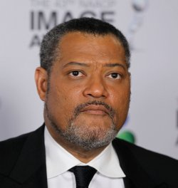 Actor Laurence Fishburne arrives at the 43rd NAACP Image Awards in Los Angeles