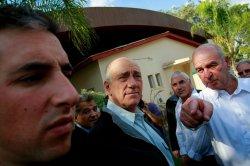 Israeli PM Olmert inspects reinforced building in Israel