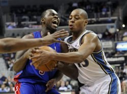 Pistons Stuckey fouled by Wizards Foye in Washington