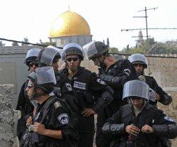 Israeli riot police adjust their gear in Jerusalem