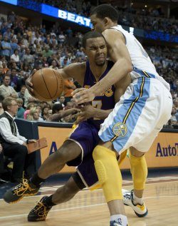 Lakers Sessions Drives Into Nuggets McGee During the NBA Western Conference Playoffs First Round Game Six in Denver