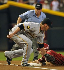 Bloomquist is safe at third in the first inning in Arizona