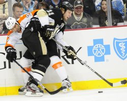 Penguins Staal checks Flyers Maxime Talbot in Pittsburgh