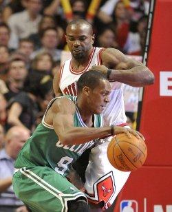 Celtics Rondo drives on Bulls James in Chicago