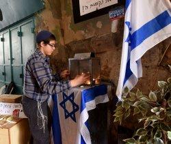An Israeli Settler Lights Memorial Candles Muslim Quarter Old City Jerusalem