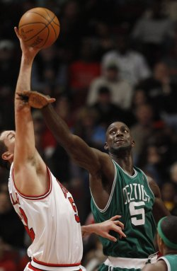 Bulls' Miller and Celtics' Garnett go for a rebound in Chicago