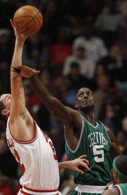 Bulls' Miller and Celtics' Garnett go for a rebound in Chicago