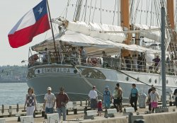 Protestors follow the Cilean Navy Tall Ship Esmeralda during five day visit to North Vancouver's Lonsdale Quay