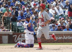 Cardinals Randal Grichuk hits a solo home run against the Cubs in Chicago