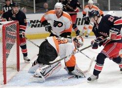 New York Rangers Derek Stepan (21) and Philadelphia Flyers Brian Boucher at Madison Square Garden in New York