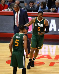 Jazz guard Joe Johnson (6) celebrates with teammate Rodney Hood (5) in front of a dejected Clippers head coach Doc Rivers
