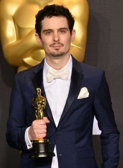 Damien Chazelle appears backstage with his Oscar at the 89th annual Academy Awards in Hollywood