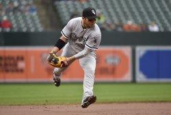 White Sox second baseman Carlos Sanchez is late fielding a single by Orioles' Jonathan Schoop