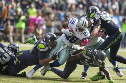 Dallas Cowboys beat the Seattle Seahawks 30-23 in Seattle.