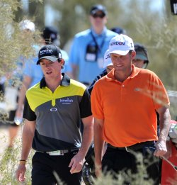 McIlroy and Hansen walk to second tee in Arizona