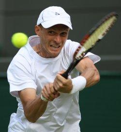 Nikolay Davydenko plays a bckhand on the first day of Wimbledon.